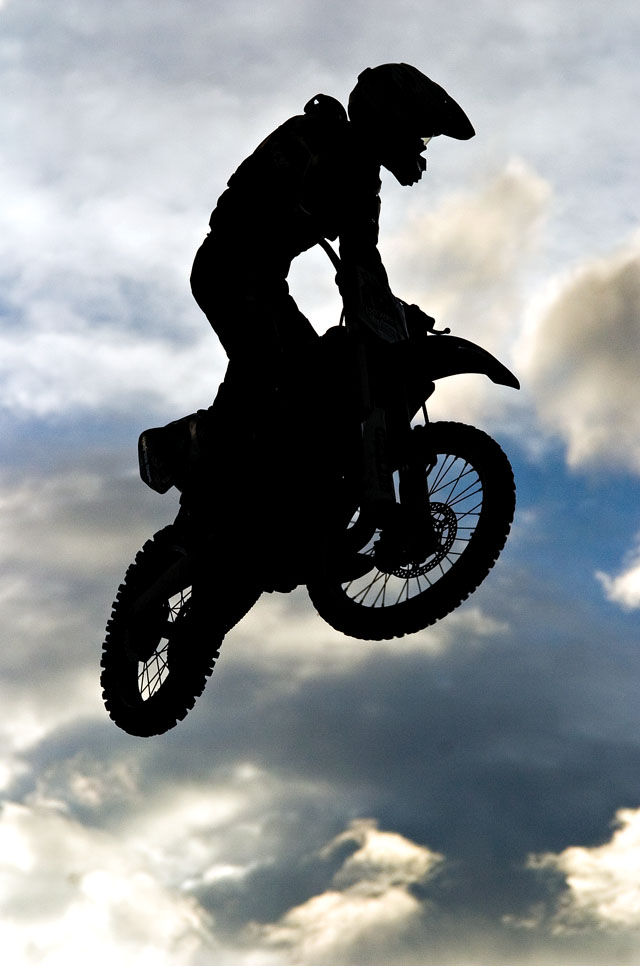 A performer clears a 70-foot gap between the take-off and landing ramps during the Planet Powersports Freestyle Motocross show at the Routt County Fair in Hayden on Friday night.