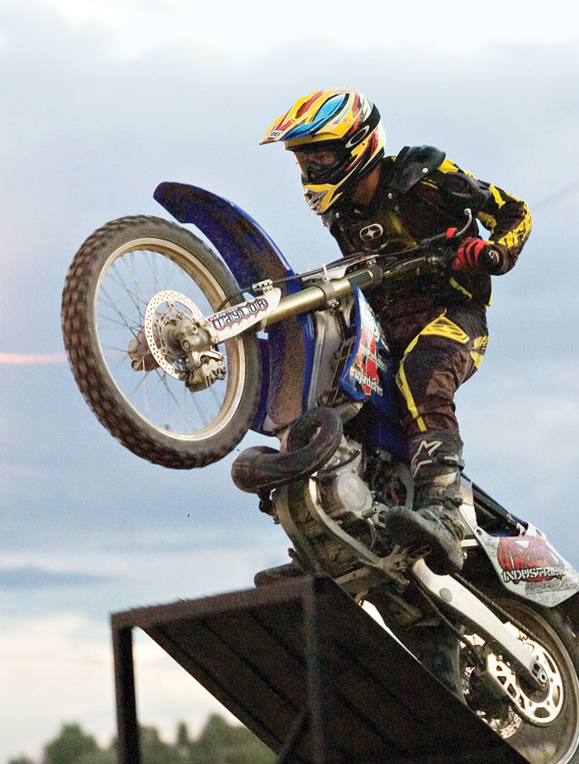 Rider Chris Taylor takes off from a ramp before clearing a 70-foot gap on the way to the landing ramp during the Planet Powersports Freestyle Motocross show at the Routt County Fair in Hayden on Friday night.