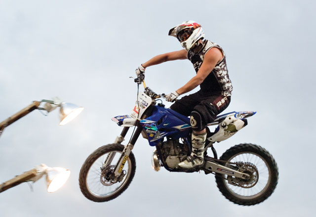 Rider Ryan Hilfiger soars through the sky during the Planet Powersports Freestyle Motocross show at the Routt County Fair in Hayden on Friday night.