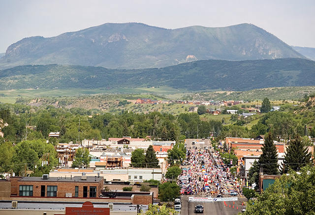 A crowd of Ford Mustang owners and enthusiasts gathers on Lincoln Avenue in Steamboat Springs on Saturday morning for the annual Rocky Mountain Mustang Roundup's Show n' Shine car show.