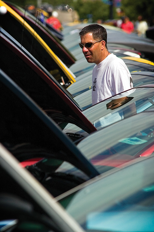 Shawn Schreiner admires a long line of Ford Mustangs parked along Lincoln Avenue on Saturday morning during the annual Rocky Mountain Mustang Roundup's Show n' Shine car show.