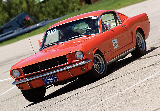 A 1965 Ford Mustang driven by Jerry Katopodes skids around a corner on the Autocross track at the Meadows parking lot in Steamboat Springs on Friday afternoon. The Autocross races were part of the annual Rocky Mountain Mustang Roundup, which included the Show n' Shine car show Saturday morning on Lincoln Avenue.