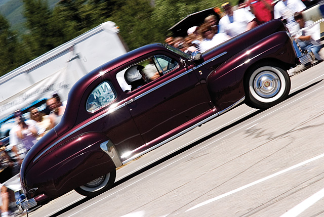 Bob Teets races off the starting line in his 1947 Ford Coupe during the Autocross competition at the Rocky Mountain Mustang Roundup in Steamboat Springs on Friday afternoon.
