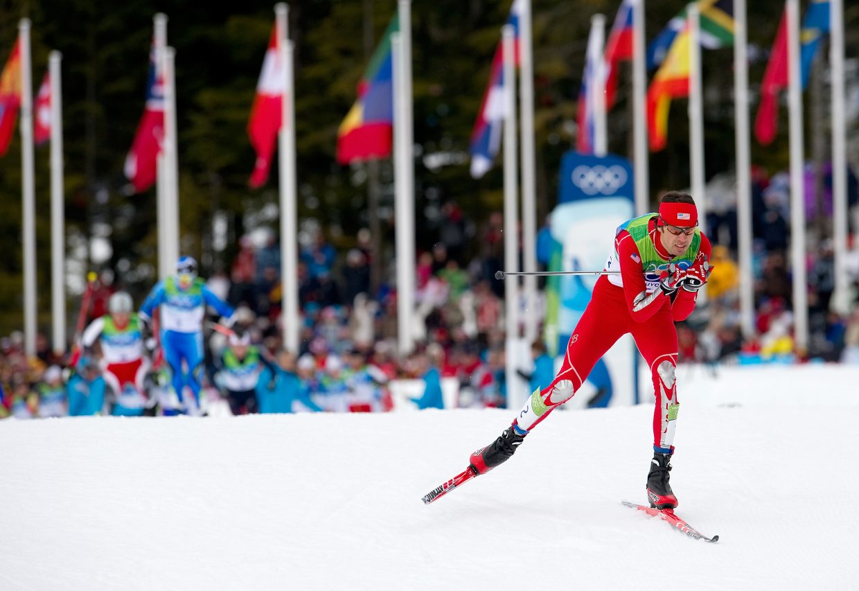 U.S. Nordic Combined Ski Team member Johnny Spillane races out of the start area of the 10-kilometer race in the individual large hill competition at Whistler Olympic Park. Spillane raced to silver in the event, and teammate Billy Demong brought home the gold.