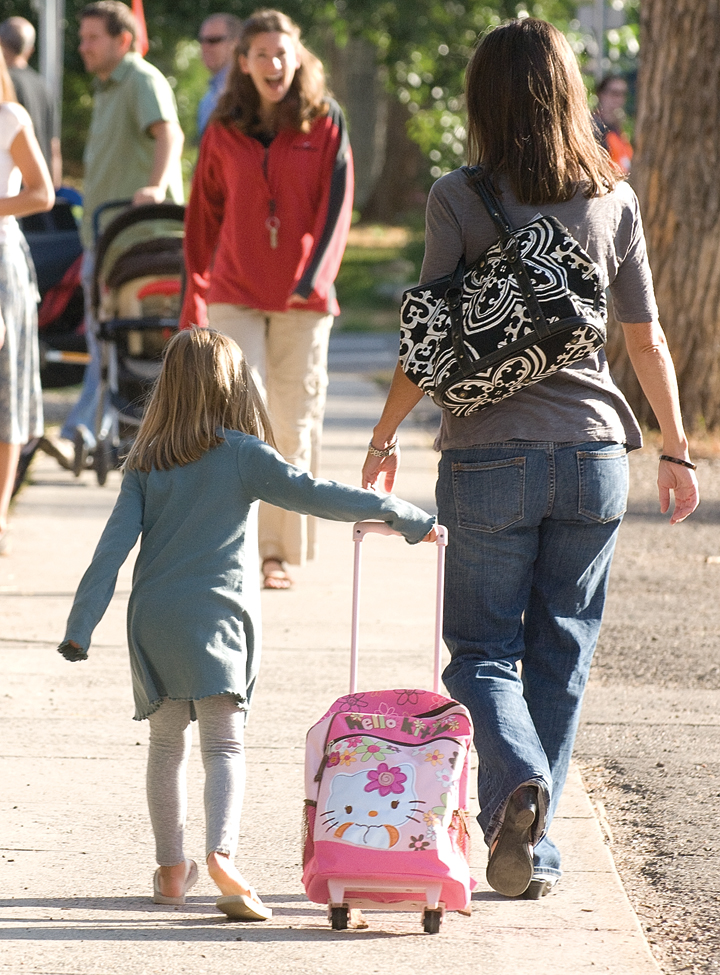 Kindergartner Audrey Fisher, and her mom, Aimee, head to class Monday as students and teachers returned to class for the start of a new school year.