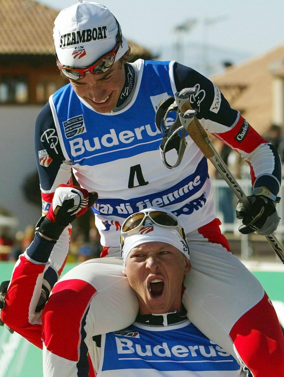 Johnny Spillane, of Steamboat Springs, is carried on the shoulders by compatriot Todd Lodwick after Spillane won the Nordic Combined Sprint 7.5 kilometers of the FIS Nordic Skiing World Championships on Feb. 28, 2003.