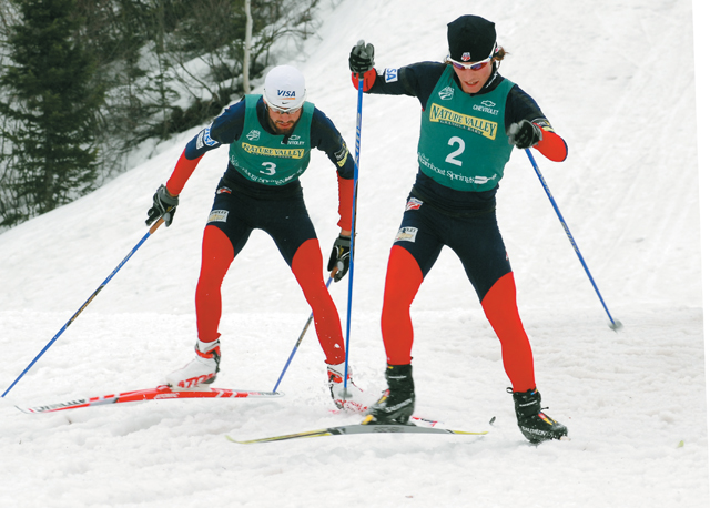 U.S. Ski Team member Brett Camerota leads Steamboat's Johnny Spillane up a hill along the 7.5-kilometer cross-country course at Howelsen. Spillane came from behind to finish second in Saturday night's race.