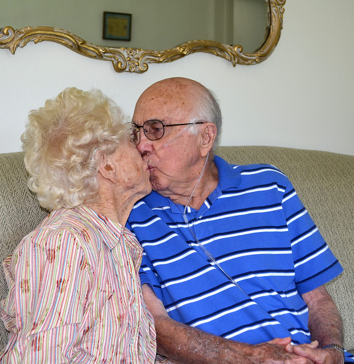 Betty and Bill Neish still like to smooch after 80 years together.