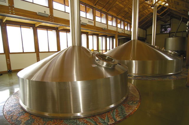 Natural light floods the New Belgium Brewing Co. brew house, complete with mosaic-lined kettle.
