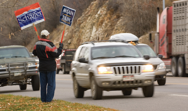 Jim Makens holds signs showing his support for Republican's Bob Schaffer, John McCain and Sarah Palin Tuesday morning near West Lincoln Park in Steamboat Springs. Voters headed to the polls Tuesday to decided several races, amendments and the next president of the United States.