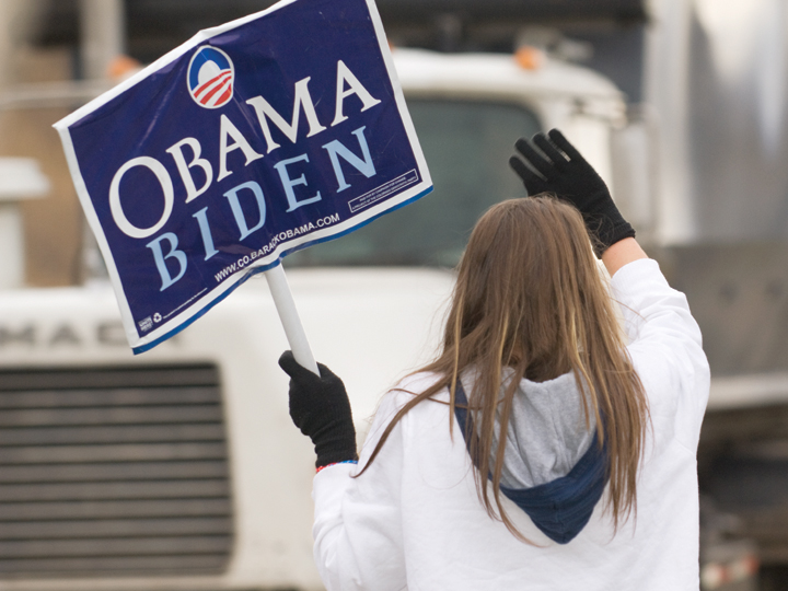 Nicole Mannon holds a sign supporter Presidential candidate Barack Obama while campaigning Tuesday morning along U.S. Highway 40. Voters headed to the polls Tuesday on the final day of the 2009 presidential election.