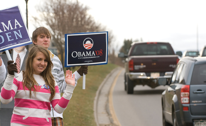 Ashley Mannon and Jean Paul Mannon hold signs, urging support for Barack Obama in Tuesday's election.