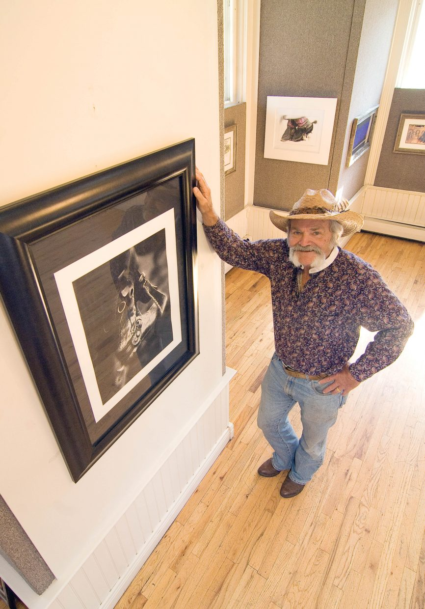 Photographer Gerald Hardage stands in front of one of the prints he is showing at the Depot Art Center. His show, which features mixed media images of the Old West, scenic mountain vistas and images from around the world, will run through the end of October.