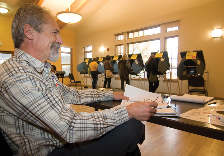Election judge Frank Bradley waits for voters at the Steamboat Springs Community Center on Tuesday morning. Bradley credited early voting for the lack of lines. Polling locations across Routt County saw little to no lines through Tuesday afternoon.