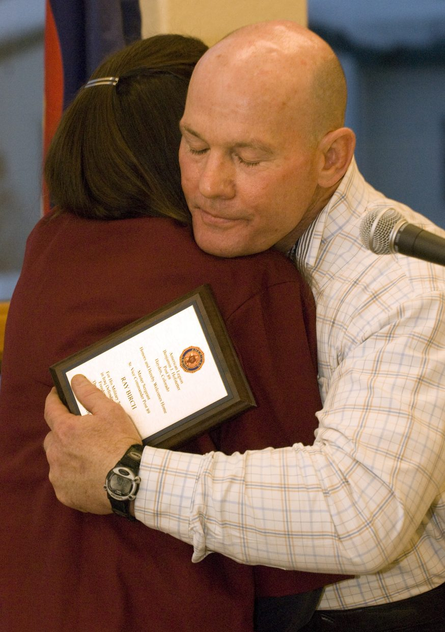 Hayden Police Chief Ray Birch hugs Lorraine Johnson during a welcome home reception at The Haven Assisted Living Center on Monday night. Birch recently returned from Iraq, where he spent 191 days.