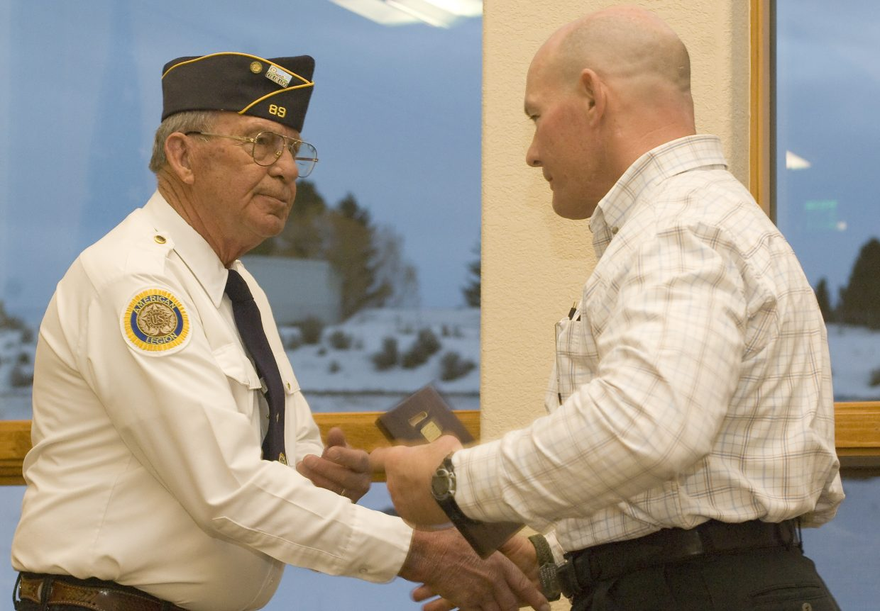 Commander Bob Hayes, of the American Legion Post No. 89, welcomes Hayden police chief Ray Birch home for Iraq during a reception at The Haven Assisted Living Center on Monday evening.