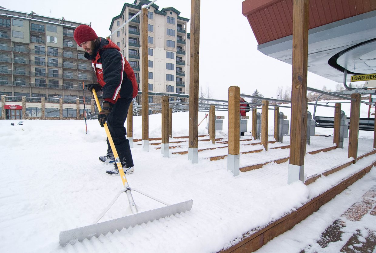 Brian Crosby rakes the snow leading to the Christie Peak Express lift between skiers Monday afternoon at the Steamboat Ski Area. The slopes will open to the public this Wednesday during the annual Scholarship Day, but the ski area has already invited the members of the Steamboat Springs Winter Sports Club's programs onto the slopes for training.