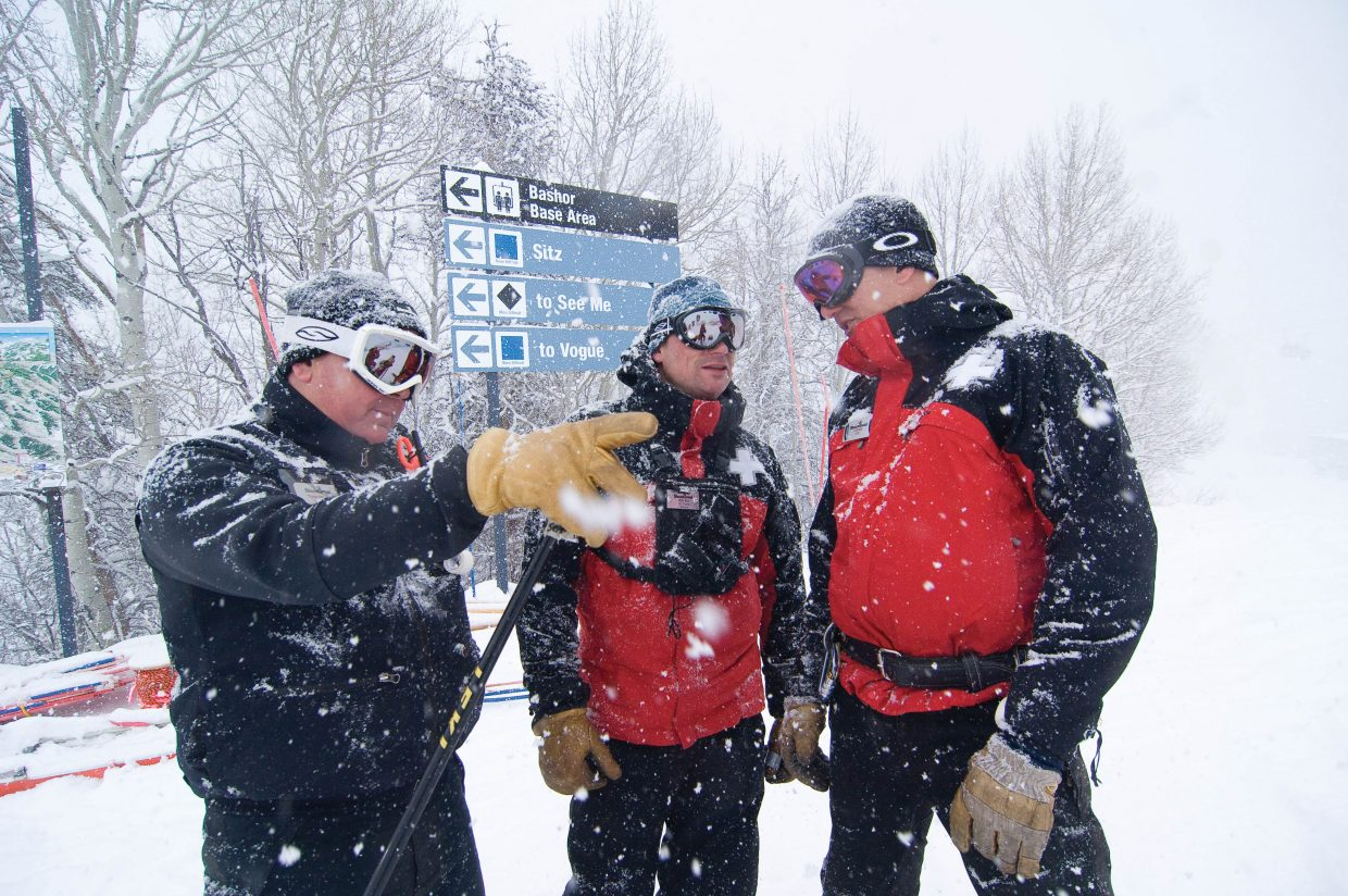 Steamboat Ski Area employees, from left to right, Todd Sepella, Andy Wick and Craig Olsheim discuss items that need to be completed before the resort's Wednesday opening. Members of the Steamboat Ski Area have already been allowed to start training on the slopes, but the official opening will come this Wednesday with Steamboat Springs Winter Sports Club Scholarship Day.