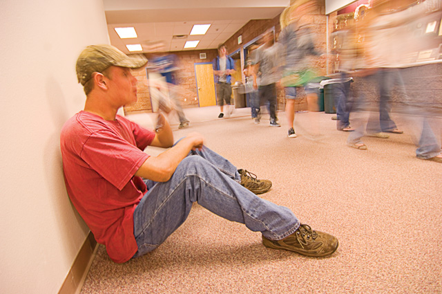 The first day of school seemed to fly by for Steamboat Springs sophomore Sam Orton who took a seat in a hallway to enjoy a drink during the hectic lunch break at Steamboat Springs High School on Monday.