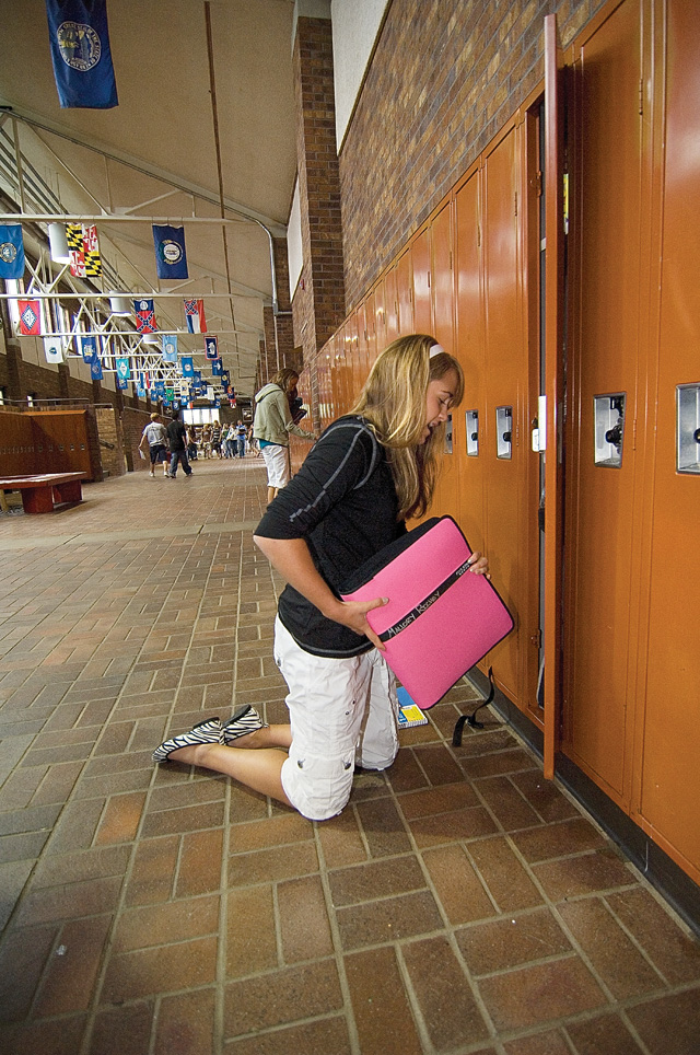 Mallory Richey puts a notebook into her locker on the first day of classes at Steamboat Springs Middle School. Richey, and her classmates, opened a new school year on Monday when they returned to classes after the summer break.