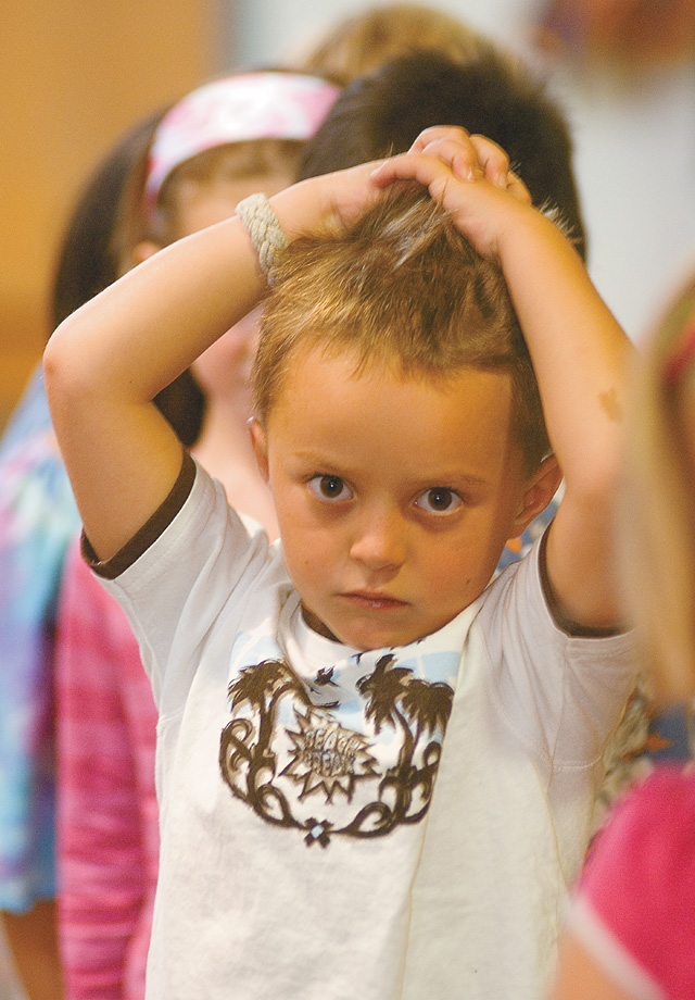 First-grader Jack Roberts waits in line to tour Strawberry Park Elementary School during the first day of classes Monday.
