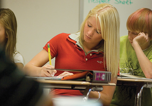 Steamboat Springs freshman Laura Bradfield listens to geography teacher Megan Hansen during the first day of classes Monday. It was back to business at the high school Monday with students returning for a new school year.