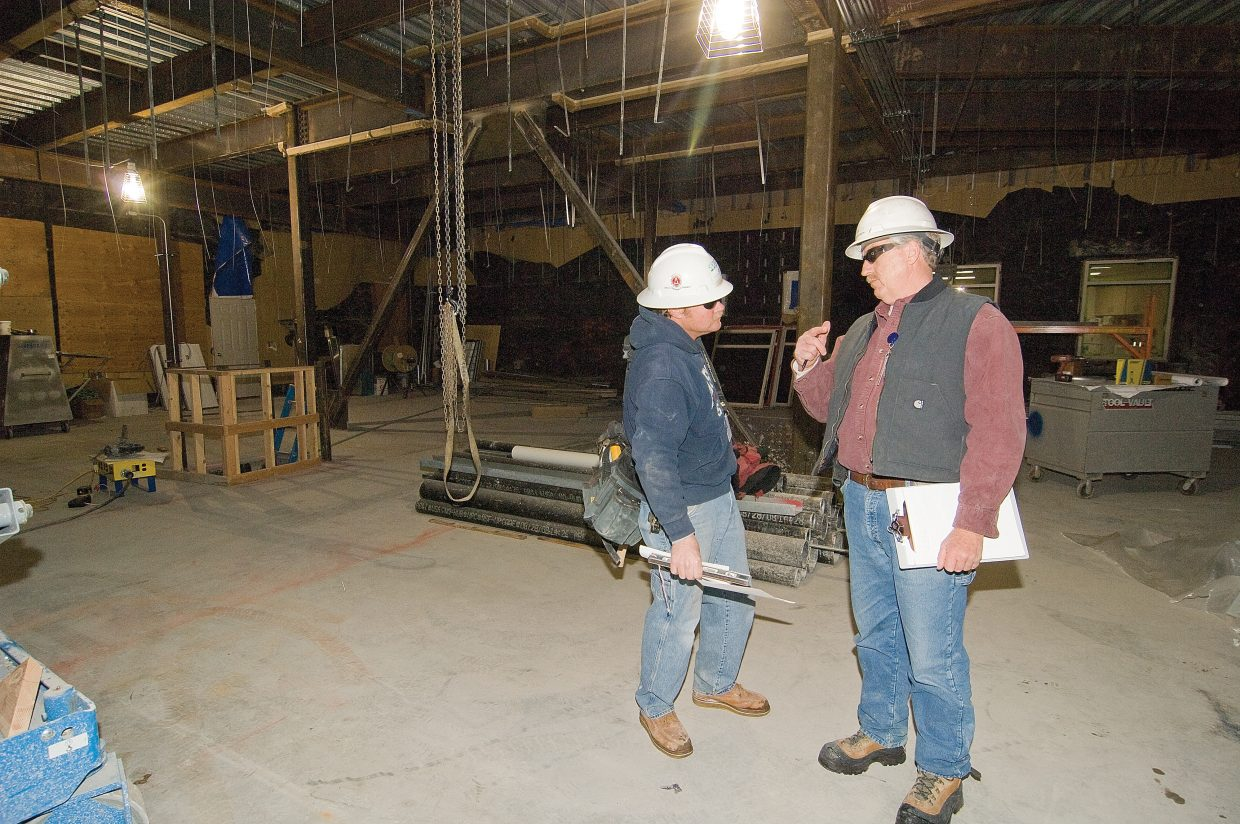 Mike Knack, project superintendent for Adolfson & Peterson Construction, chats with Assistant Superintendent David Manley inside a new addition at the Yampa Valley Medical Center. The $13 million renovation is scheduled for completion in fall 2009.