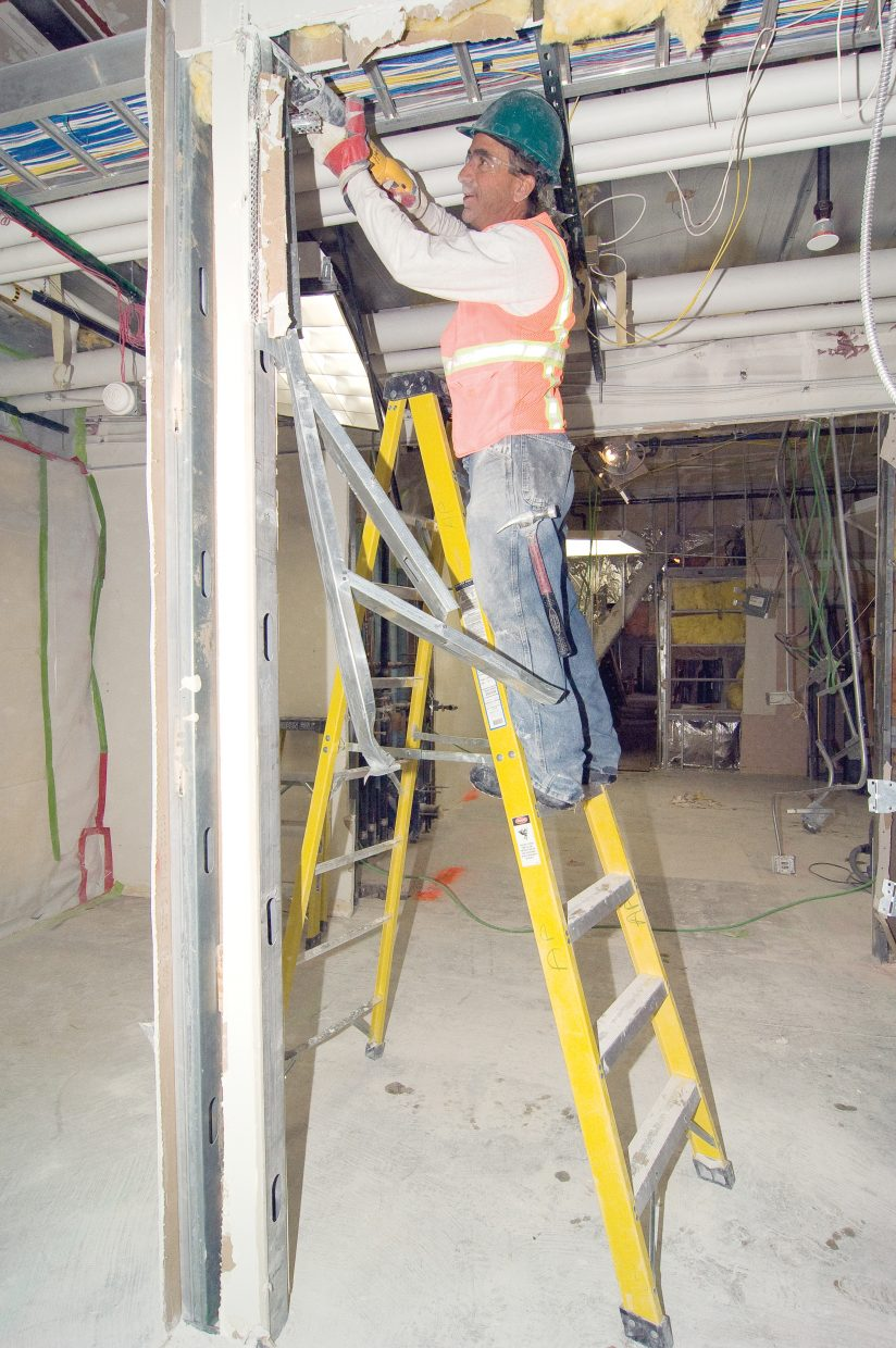 Construction worker Robert Dickey uses a saw to remove parts of the ceiling in the old maternity ward at Yampa Valley Medical Center. Dickey is working for Adolfson & Peterson Construction, which is in the middle of a $13 million renovation at the Yampa Valley Medical Center.