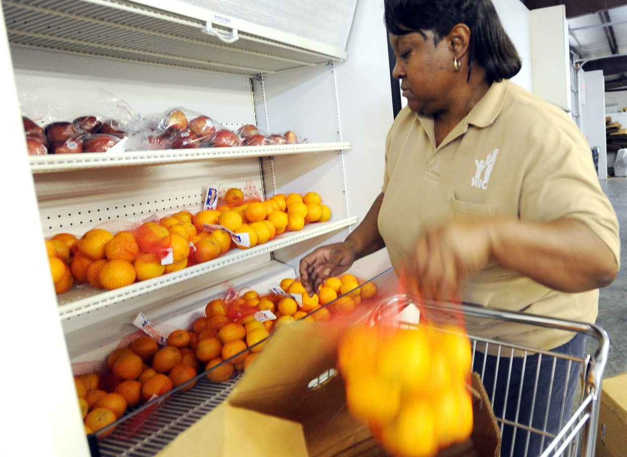 Lucille Meeky, warehouse manager for the Women, Infants and Children's Nutrition Program in Holmes County, stocks shelves with fresh oranges. WIC is a federal supplemental food programs that helps new and expectant mothers as well as children younger than 5 receive healthy foods and health care referrals. In April of this year, 90,708 individuals participated in WIC in Mississippi alone.