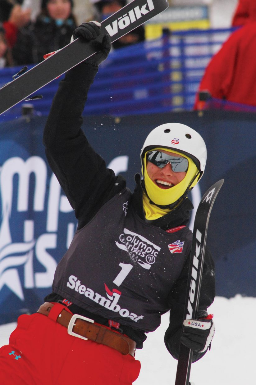 Jeret Peterson celebrates after taking the lead in the freestyle aerial event Thursday.