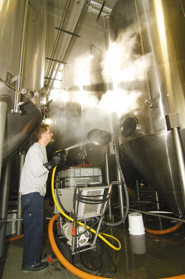 Greg Wiggall cleans a tank at the Odell Brewing Co. in Fort Collins. He said keeping the tanks free of contaminants is a key to making great-tasting beer.