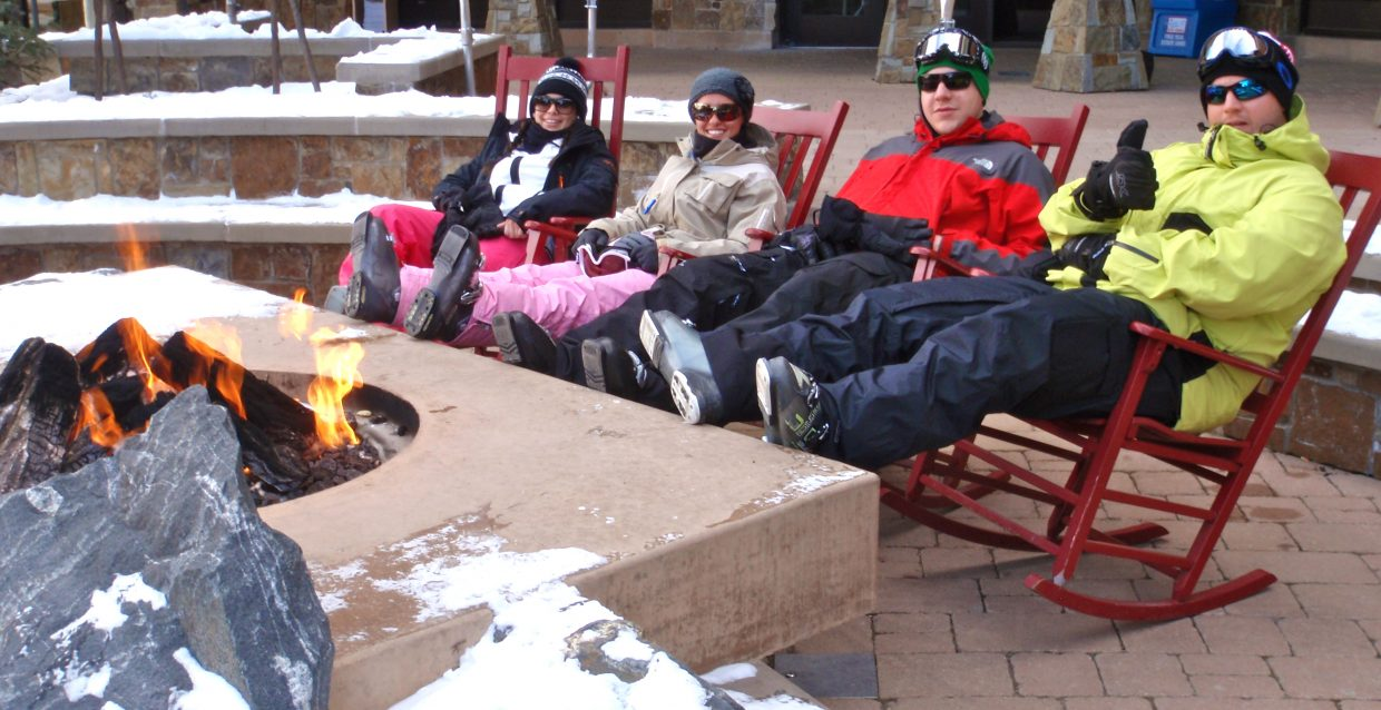 Skiers take a break from skiing by the fire pit in front of One Steamboat Place on Jan. 14.Submitted by: Marie-Beth Cheezem