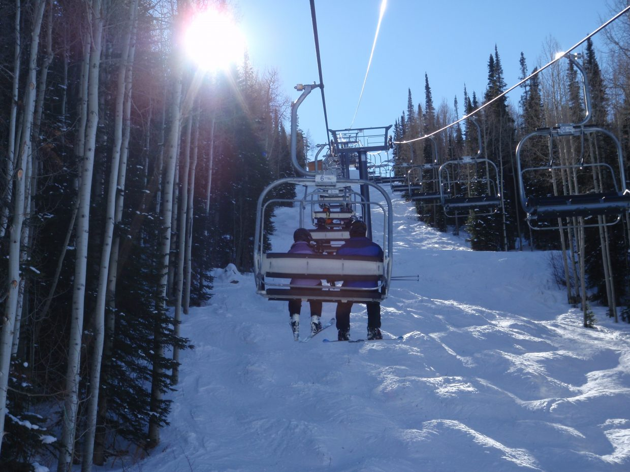 A pair of skiers ride up the Burgess Creek chairlift at Steamboat Ski Area. Submitted by: Marie-Beth Cheezem