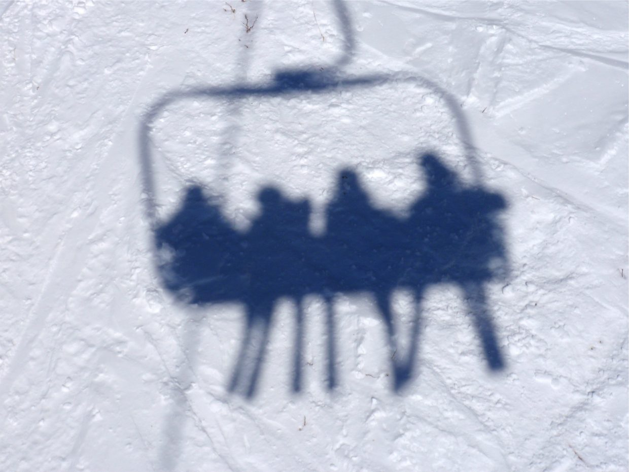 Shadows of skiers on the Sunshine Express chairlift. Submitted by: Marie-Beth Cheezem