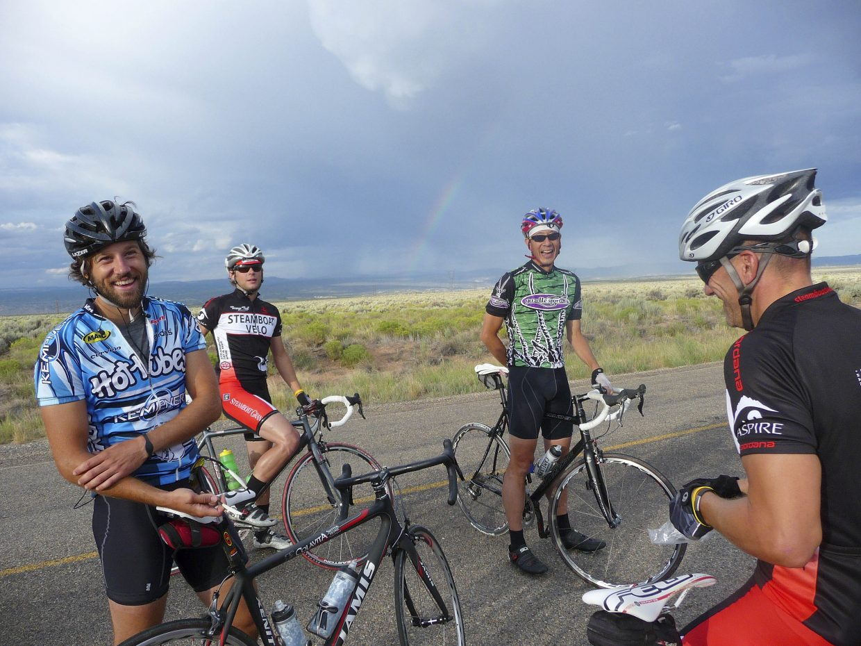 Riders, from left, Tim Reinhart, Trevor Walz, Ken Sung and Mark Satkiewicz laugh during a break in Utah.