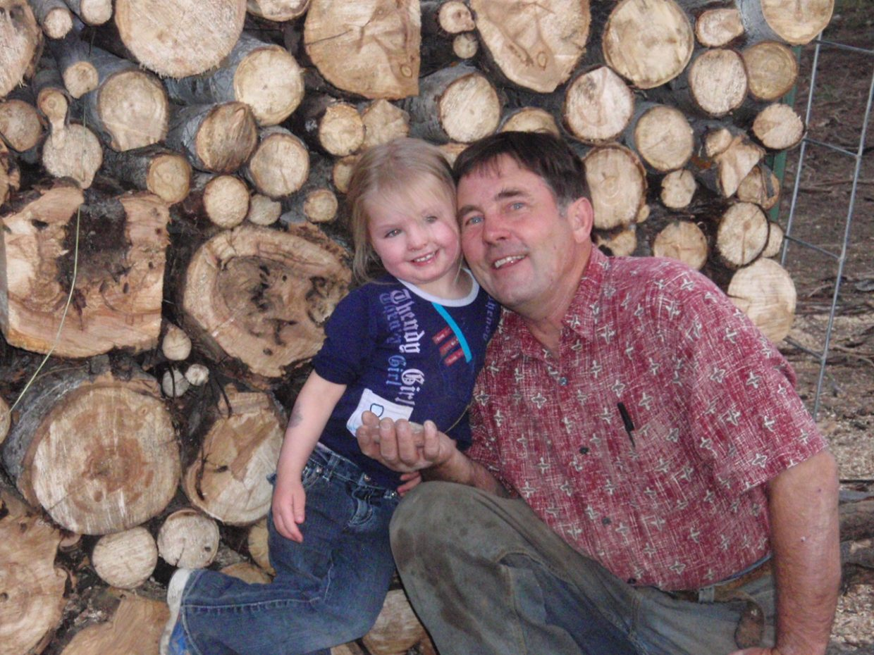 Getting ready for winter! Greta Martin helps her grandpa Scott May with firewood. Submitted by: Candice May Martin