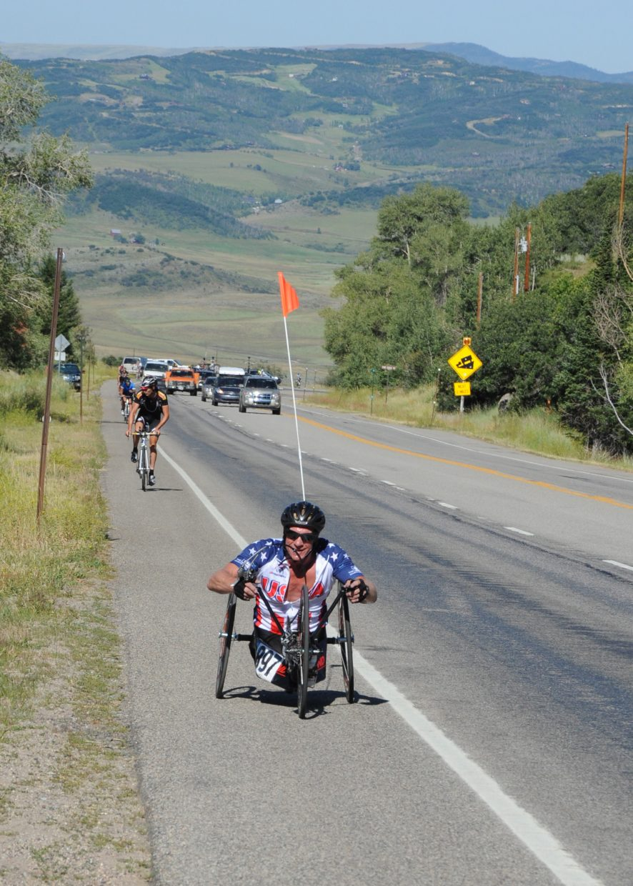 Hand cyclist Dane Pilon going up Rabbit Ears Pass before the pros.