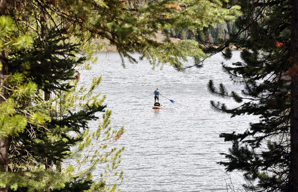 A stand-up paddleboarder glides on Pearl Lake on Saturday afternoon. Warm weather at the park attracted hikers, boaters and anglers to the lake in North Routt County.