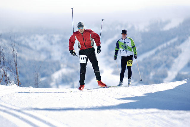 Kyrill Kretzschmar, left, and Jeff Snook race through the cross country skiing course during the Steamboat Pentathalon held at Howelsen Hill on Saturday.