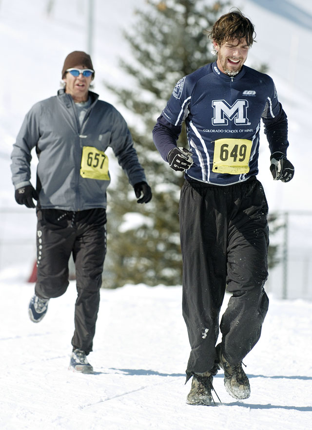 Duncan Proctor, right, and Travis Taylor compete in the running segment of the Steamboat Pentathlon at Howelsen Hill on Saturday morning. Both men were participating in the men's individual short course competition.