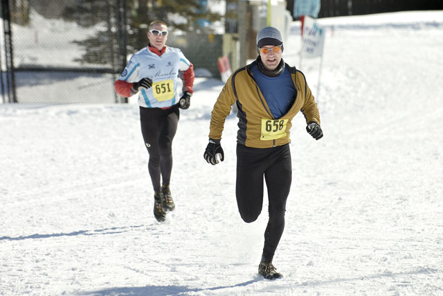 John Van Eden, front, and Ian Gale race toward the finish line during the final running segment of the Steamboat Pentathlon at Howelsen Hill on Saturday morning. Van Eden and Gale finished second and third, respectively, in the men's individual short course competition.
