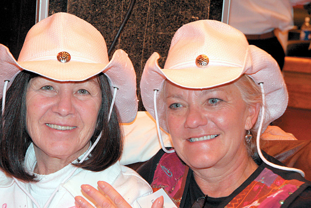 Anne Hood, left, and Vicki Marsden show off their smiles and matching cowboy hats at Three Peaks Grill.
