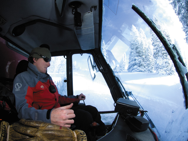 Todd Dills drives a snowcat up a road in the Buffalo Pass backcountry last winter. Dills, a guide with Steamboat Powdercats, takes his turn driving the cat and guiding skiers through the untracked runs.