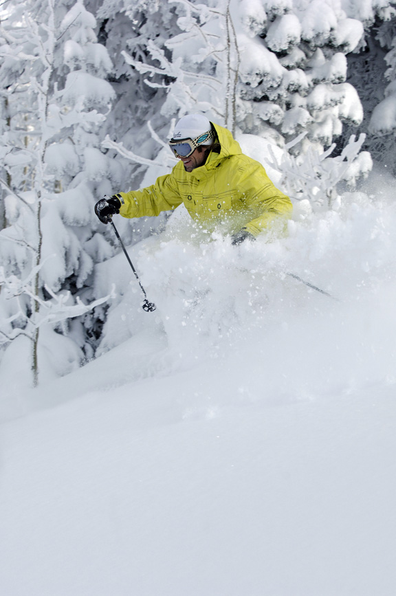 Nelson Carmichael can't help but smile while ripping through powder Friday morning at the ski area.