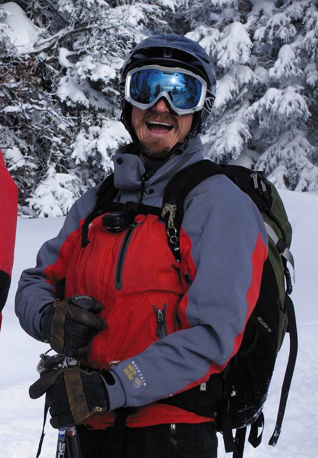 Steamboat Powdercats guide Bill Murphy laughs while visiting with clients between runs during a trip into the  backcountry.