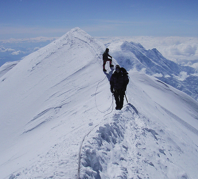 """Steamboat's Brick Root, 54, called his summit of Mt. McKinley on June 15, pictured here on the 20,320-foot summit ridge (foreground), as the, """"grand finale,"""" to an accomplished mountaineering career with his son, Bridger."""