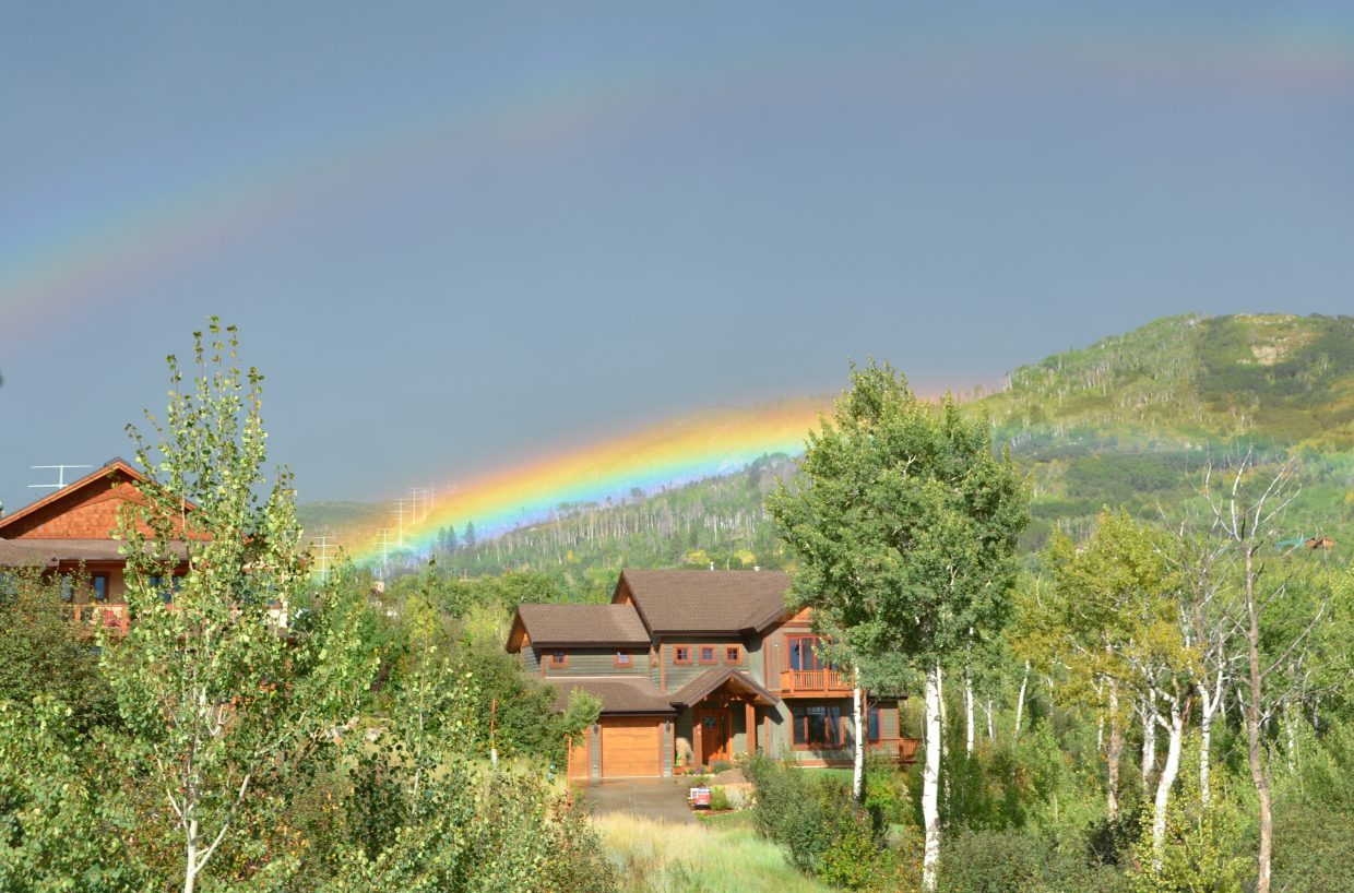 Rainbow in Steamboat hovering low along the treeline. Submitted by: Shannon Lukens