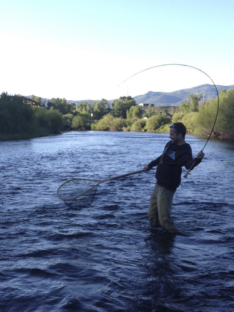Adam Geisler struggles to land a trophy rainbow on the Yampa River on Sunday evening. Submitted by: Nikki Byrum