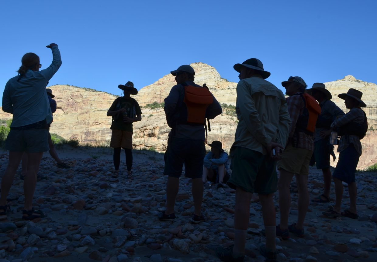 A tribe of semi-nomadic river runners taking part in the Yampa River Awareness Project gathered on a heavily cobbled sand bar along the river in Dinosaur National Monument on June 10 to listen as Prof. Pat Tierney, of San Francisco State University, talk about migration patterns of the endangered Pikeminnow.