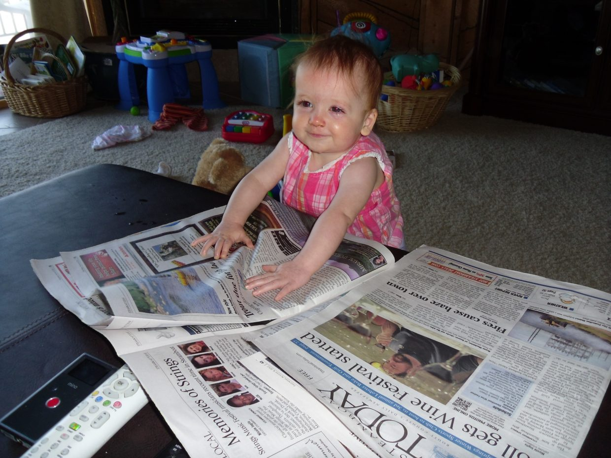 Madeline, 8 months, just catching up on the news in the Saturday Steamboat Today. Submitted by: Kimberly Butler